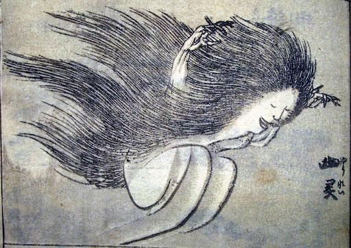 Ausschnitt aus einer Seite aus den Hokusai Manga: eine lächelnde Geister-Dame (Yūrei), mit angezogenen Beinen, wirkt wie fröhlich durch die Luft hüpfend.